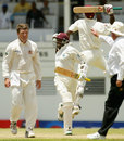 Vasbert Drakes and Omari Banks celebrate the win, West Indies v Australia, 4th Test, St John's, Antigua, 5th day, May 13, 2003