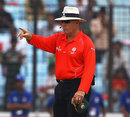 Umpire Daryl Harper makes a decision