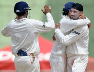 Harbhajan Singh is congratulated on his 400th wicket, West Indies v India, 3rd Test, Dominica, 2nd day, July 7, 2011