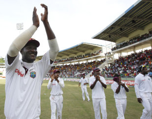 Darren Sammy and the West Indian team salute the crowd for their support, West Indies v India, 3rd Test, Dominica, 5th day, July 10, 2011