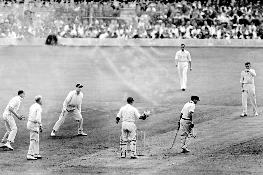 Maddocks walks off after being bowled by Jim Laker on day two at Old Trafford, 1956. Three days later, he would be the last man out, lbw to Laker