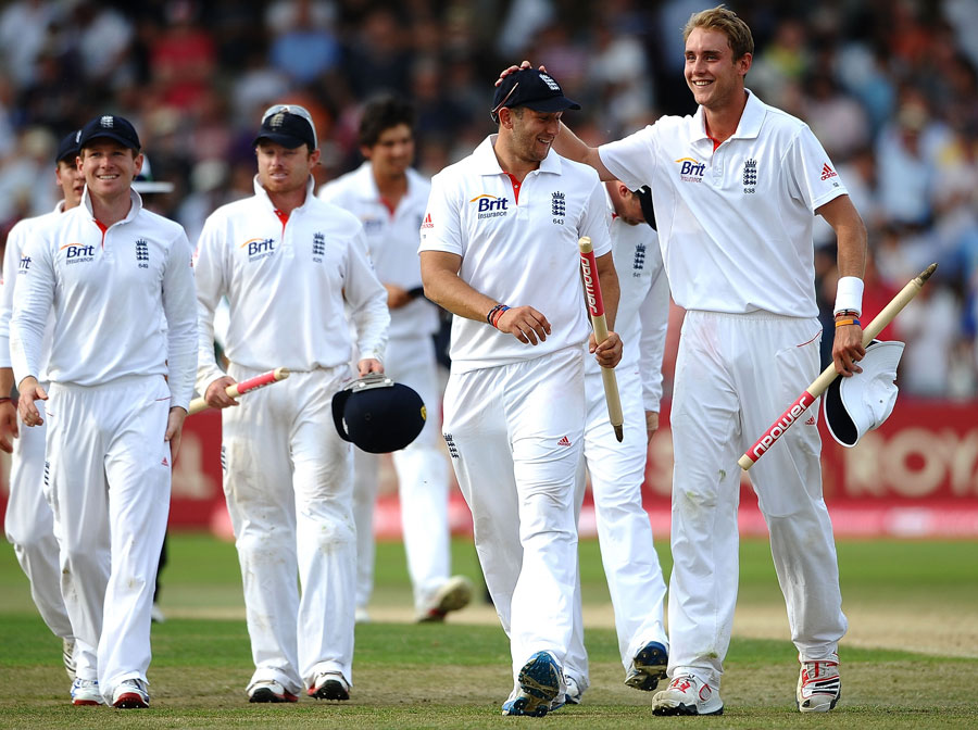 Stuart Broad and Tim Bresnan lead the victorious England side off the field