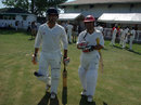 Afghanistan openers Noor Ali Zadran and Karim Sadiq head out to bat in the first innings