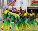 The Vanuatu fielders celebrate the fall of a wicket