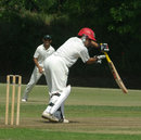 Afghanistan's Karim Sadiq edges the ball to the keeper