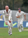 Gary Keedy celebrates his dismissal of Will Porterfield