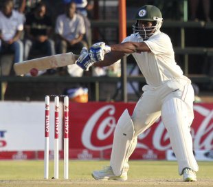 Zimbabwe opener Tino Mawoyo reaches out for the ball