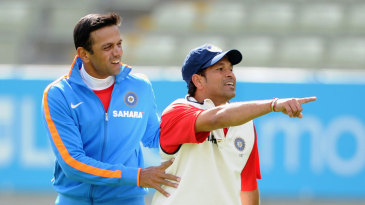 Rahul Dravid and Sachin Tendulkar share a light moment during practice