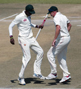 Chris Mpofu and Ray Price do a jig after Zimbabwe win