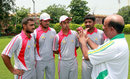 Tauseef Ahmed, the PCB's regional head coach for Hyderabad, illustrates a point while talking to young cricketers