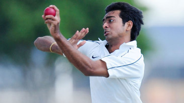 Jaydev Unadkat is all concentration as he is about to release the ball
