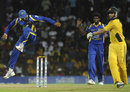 Tillakaratne Dilshan jumps as he tries to evade a throw, Sri Lanka v Australia, 4th ODI, R Premadasa Stadium, Colombo, August 20, 2011