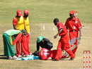 Keegan Meth is attended to after being hit on the face while following through, Zimbabwe v Bangladesh, 5th ODI, Bulawayo, August 21, 2011