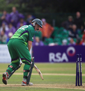 Kevin O'Brien looks back to see his stumps disturbed