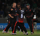 Andrew McDonald is mobbed after taking Craig Kieswetter's wicket