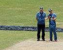 Greg Chappell and Michael Clarke take a close look at the pitch, Galle, August 29, 2011