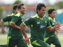 Assistant coach Aaqib Javed warms up with the team, Auckland, December 21, 2011