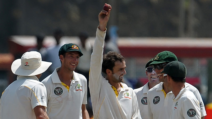 Nathan Lyon celebrates his five-wicket haul on debut