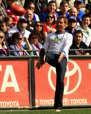 Shane Warne entertains the crowd at an Australian Football League match, Melbourne, September 3, 2011
