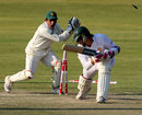 Adnan Akmal tries to stump Kyle Jarvis