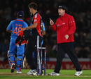 Jade Dernbach is reprimanded by umpire Rob Bailey after a spat with Suresh Raina