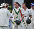 John Mooney and Andrew White are congratulated by the Namibia fielders after the match, Ireland v Namibia, Intercontinental Cup, 1st day, Belfast, September 9, 2011