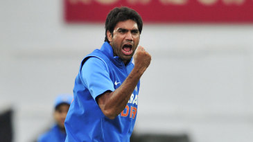Munaf Patel celebrates after removing Alastair Cook