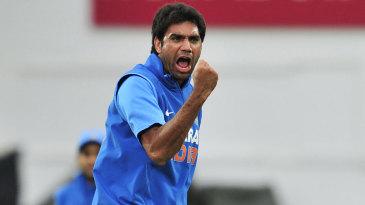 Munaf Patel celebrates after removing Alastair Cook