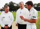 Geraint Jones inspects the pink ball with umpires Martin Bodenham (right) and Nigel Cowley (left)