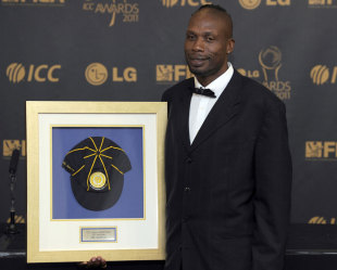 Curtly Ambrose sports his memento after being inducted into the ICC Hall of Fame