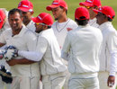 Khurram Chohan is congratulated by his team-mates after dismissing Andrew White, Ireland v Canada, Intercontinental Cup, 1st day, Dublin, September 13, 2011