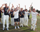 Lancashire's players celebrate securing the Championship title