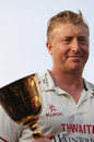 Lancashire captain Glen Chapple holds the County Championship trophy