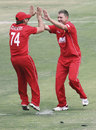 Charles Coventry gets a high five after running out Asad Shafiq, Zimbabwe v Pakistan, 1st Twenty20, Harare, September 16, 2011