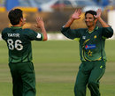 Aizaz Cheema and Yasir Shah celebrate Kyle Jarvis' dismissal, Zimbabwe v Pakistan, 1st Twenty20, Harare, September 16, 2011
