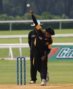 Suresh Navaratnam steams in for Malaysia, Malaysia v Kuwait, World Cricket League Division Six, Kuala Lumpur, September 17 2011