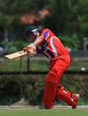 Corey Bisson drives during his half-century, Jersey v Kuwait, World Cricket League Division Six, Kuala Lumpur, September 19 2011