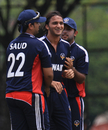 Saad Khalid is congratulated after removing Jersey's opener, Jersey v Kuwait, World Cricket League Division Six, Kuala Lumpur, September 19 2011