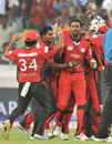 Janaka Gunaratne is congratulated on dismissing Lendl Simmons, Ruhuna v T&T, CLT20 qualifier, Hyderabad, September 19, 2011