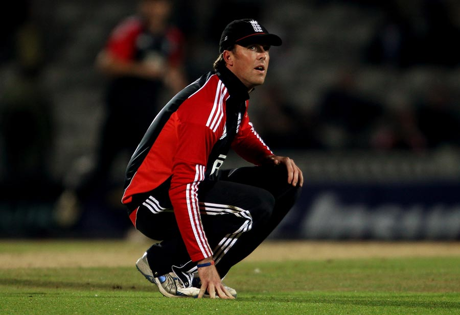 Graeme Swann squats on the turf