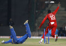 Kevon Cooper is ecstatic after Harbhajan Singh is run-out