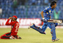 Yuzvendra Chahal is ecstatic after Mumbai Indians beat Trinidad & Tobago off the last ball, while Sunil Narine slumps to the ground, Mumbai Indians v Trinidad & Tobago, Champions League T20, Bangalore, 26 September, 2011