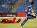 Yuzvendra Chahal celebrates after hitting the winnings runs, Mumbai Indians v Trinidad & Tobago, Champions League T20, Bangalore, 26 September, 2011