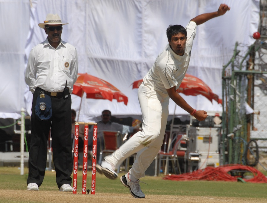 Rahul Sharma bowls on the third day