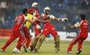Royal Challengers Bangalore players rush to congratulate Arun Karthik, Royal Challengers Bangalore v South Australia, Champions League T20, October 5, 2011