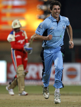 Pat Cummins is overjoyed after picking up the wicket of Tillakaratne Dishan, RCB v NSW, 1st semi-final, CLT20, Bangalore, October 7, 2011