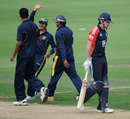 The Hyderabad XI celebrate Alastair Cook's downfall