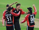Steven Finn is congratulated after taking at hat-trick against Hyderabad XI