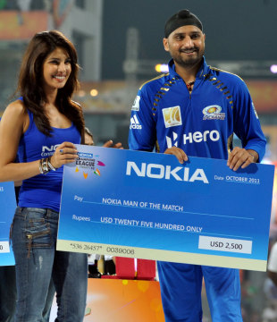 Priyanka Chopra hands Harbhajan Singh the Man-of-the-Match cheque, Mumbai Indians v RCB, CLT20 final, Chennai, October 9, 2011