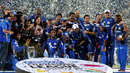The Mumbai Indians team pose with the CLT20 trophy